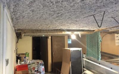 Isolation par flocage d'un sous sol